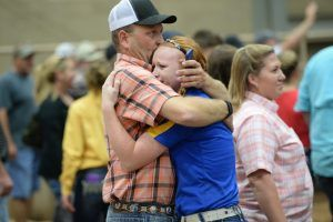 Deuces! Johnna Stottlemyre and her dad after she won her second Grand Championship at the Tulsa State Fair.